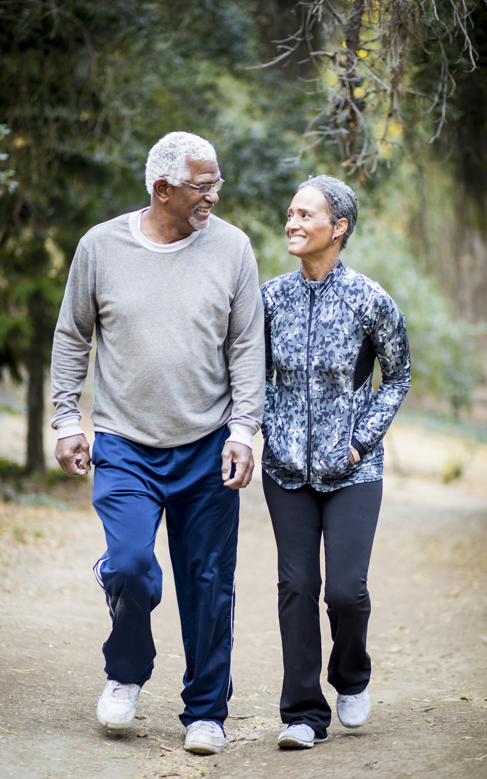 An older black couple outside on a walk.