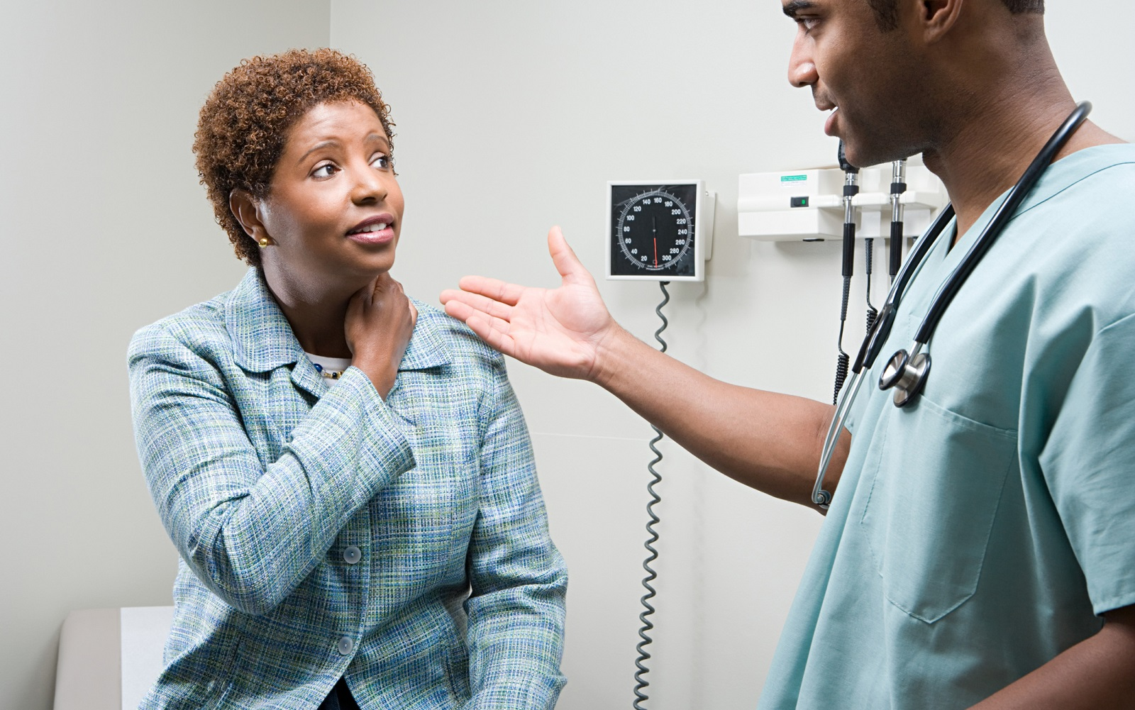 An African-American woman speaking with a male clinician
