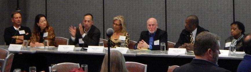Susan Kullberg (second from the left) and Barry Schatz (fifth from the left) participate in a panel discussion at one of the engagement project's symposia.