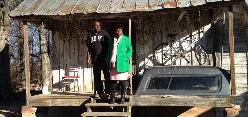 Freddie White-Johnson visits the home of a man who is experiencing prostate cancer symptoms. In addition to giving him information about cancer screening, she noticed he had no heat and brought him an electric heater. (Photo courtesy of Freddie White-John