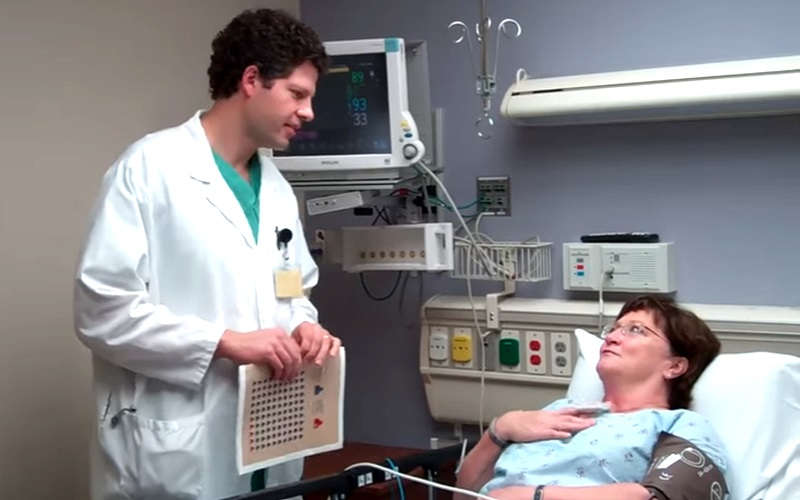 Erik Hess uses the decision aid his PCORI-funded project developed to discuss options with a patient with chest pain in the emergency room