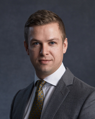 A headshot of Jonathan Moore, Associate Director of Public Engagement.