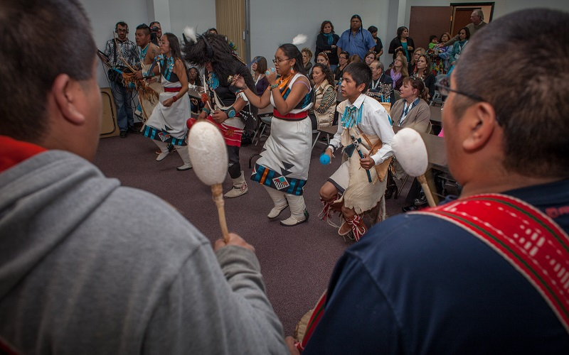 Young members of the Zuni tribe perform a traditional dance during a PCORI staff visit in 2013