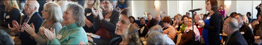 Participants at a PCORI Annual Meeting Pre-Conference Workshop listening to speakers and chatting.