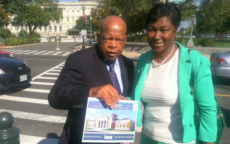 Freddie White-Johnson and Congressman John Lewis pose after a meeting in Washington, DC.