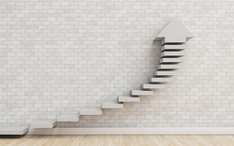 A series of steps leading up with a an arrow