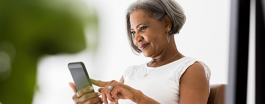 An older African American woman using her smartphone.