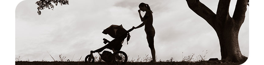 An image showing a silhouette of a woman pushing an infant's stroller