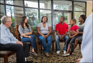 A multi-ethnic group in a discussion with a health expert