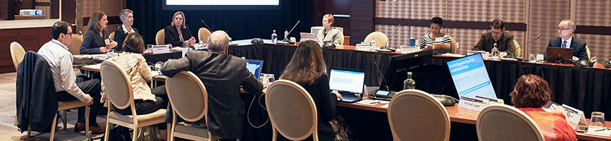 A photo of a meeting of the PCORI's Board of Governors in a hotel ballroom.