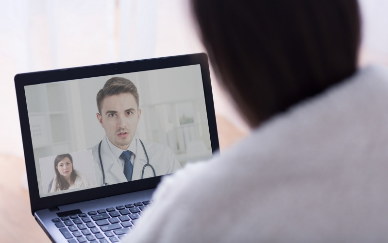 A woman having an online consultation with her GP.